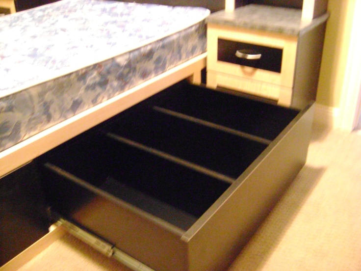 complete with 4 sliding underbed storage drawers