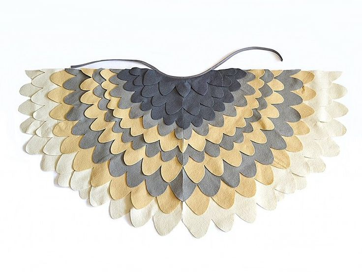 Dress up wing cape for children. Excellent as a dress up accessory for a barn owl or snow owl costume for any kid.