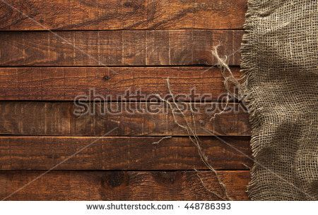 Wood table with old burlap tablecloth texture