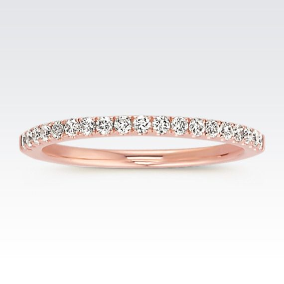 Nineteen round diamonds, at approximately .26 carat total weight, give this elegant band radiance. These exquisite, hand-matched stones are set in the finest 14 karat rose gold.