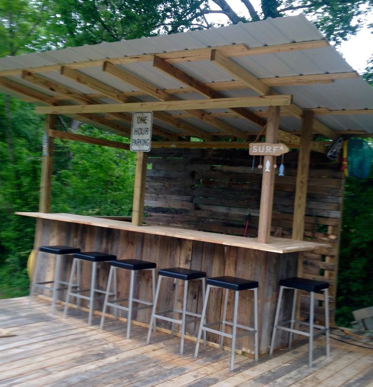 """Our little """"tiki bar"""" from pallet wood and salvaged metal roofing and acacia countertops. Still a work in progress but I love it!"""