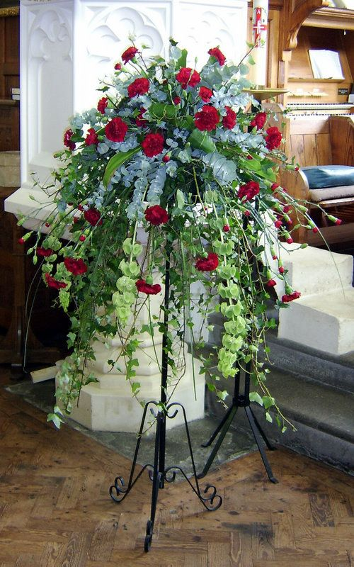 Cascade pedestal floral arrangement, styled with Carnations and Eucalyptus Styled by Susan Beese @ portishead wedding flowers.co.uk