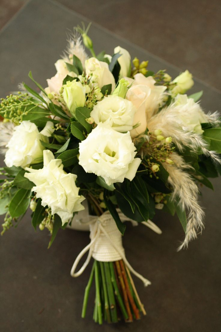 lisianthus wedding bouquets | Handtied modern wedding bouquet featuring white lisianthus, roses