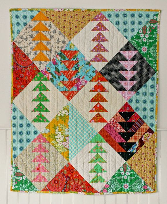 This quilt is jammed full of joyful color and movement. Triangles fly up and down the quilt, giving the impression of flying geese. Each block