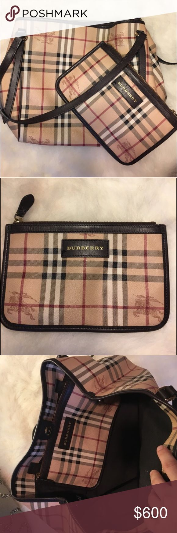 Burberry Tote With Detachable Clutch 100% authentic. Perfect for fall! In great condition. Just a little wear on the bottom leather piping as well as a couple spots on the inside lining and pouch. Only worn a handful of times. Can expand into a wider tote and the clutch has a zipper closer, also removable. (Crossposted with Chicinlove's closet). Burberry Bags Totes