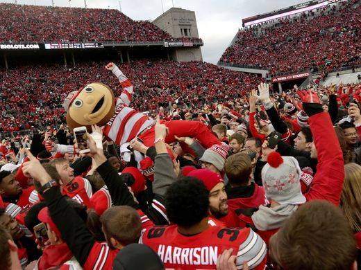 Brutus the Buckeye, Ohio State's mascot is lifted into