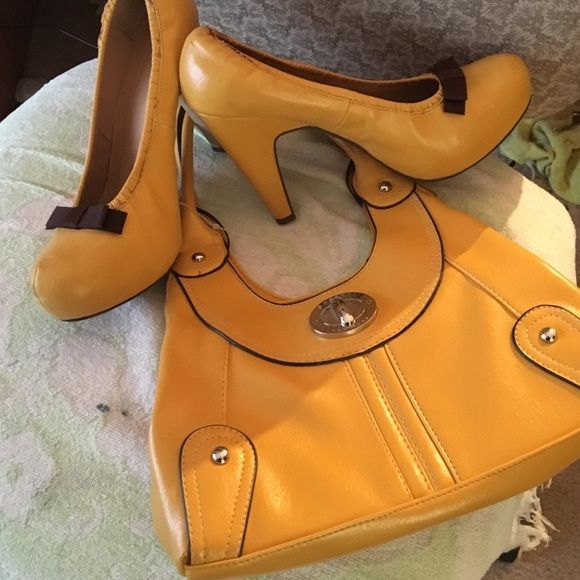 """Mustard shoe and matching purse Mustard 2 1/2 """" heal with small hand bag Miss Me Shoes Heels"""