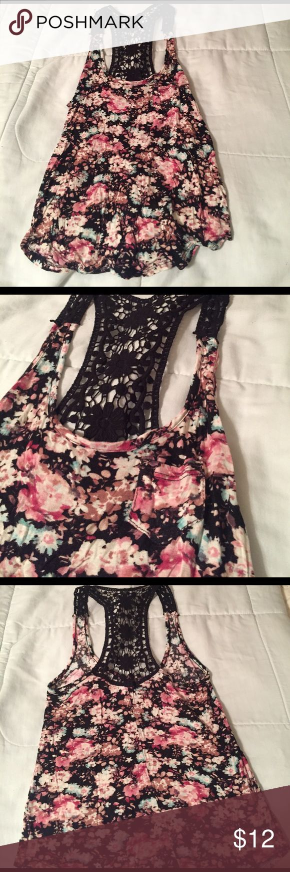 Tilly's floral tank Floral razorback tank with crocheted back. The colors are magenta, light pink, baby blue, cream, and black. This top is in perfect condition. Fits slightly loose. Full Tilt Tops Tank Tops