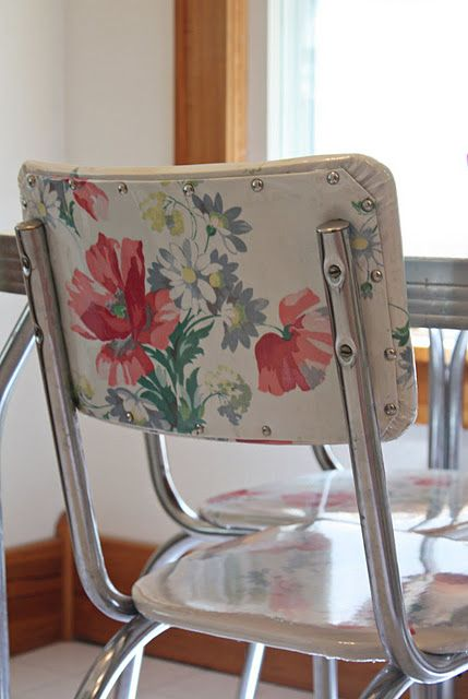 Vintage chairs covered with vintage tablecloths! Oilcloth might work nicely here.