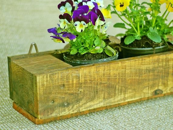 Small practical shelf made of pallet wood as flower shelf, or kitchen shelf for spices, or for bathroom utensils, pallet wood shelf