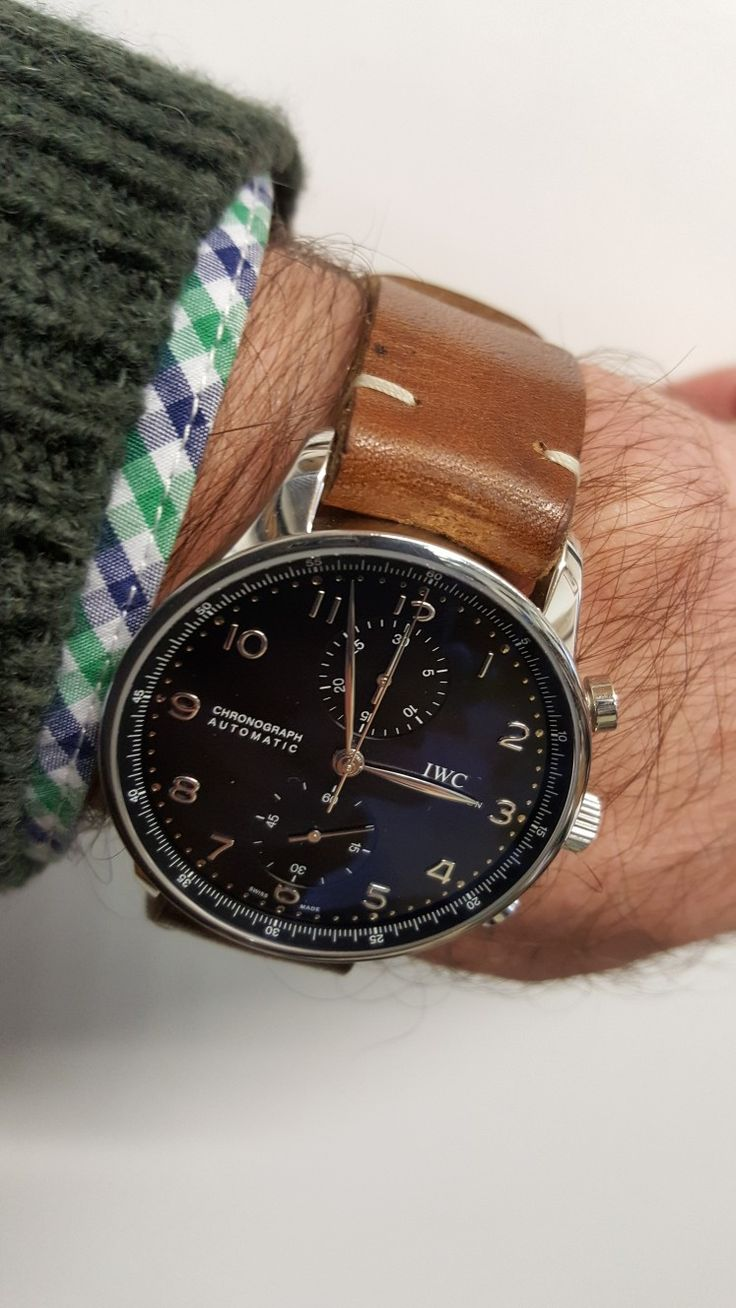 IWC Portuguese chronograph with handmade brown leather strap. Black dial.