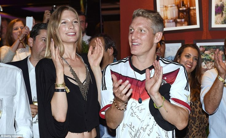 Soaking up the applause: The party continued at the Sheraton Hotel where Schweinsteiger di...