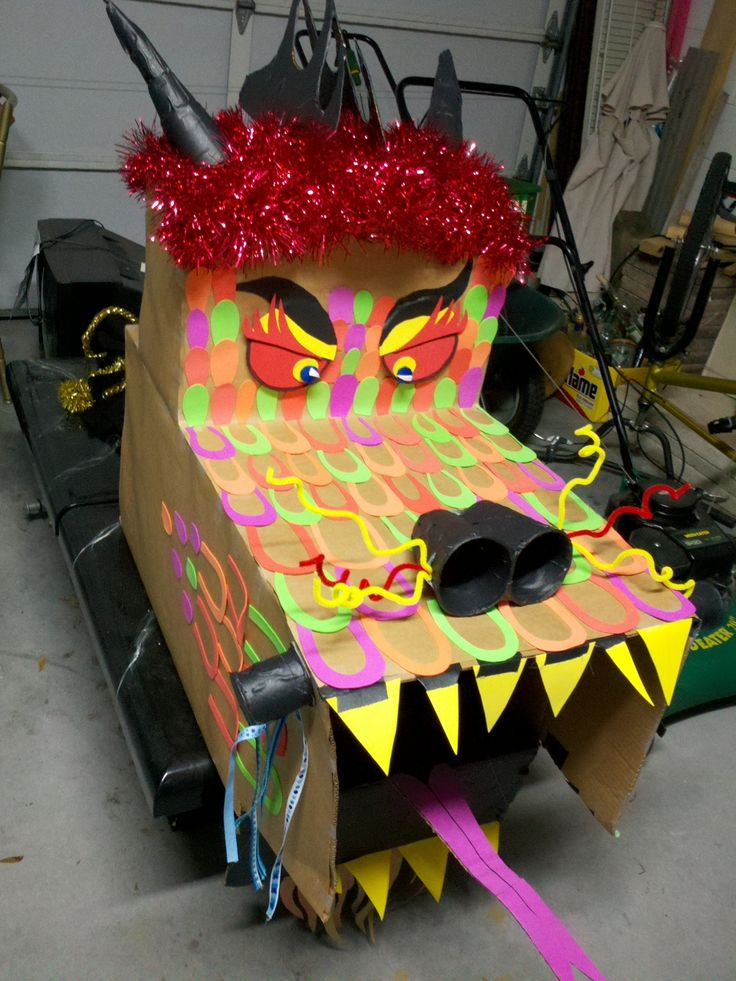 In celebration of Dragon Appreciation Day, my co-workers used things from the supply closet at work and created a Chinese Dragon from cups, gaff tape, foam, old garland and a cardboard boxes. They even shot video of the ceremony they where they paraded it around work just like a Chinese dragon in a parade. It might seem silly to some but to me? There's never been or never will be a more beautiful Chinese dragon.