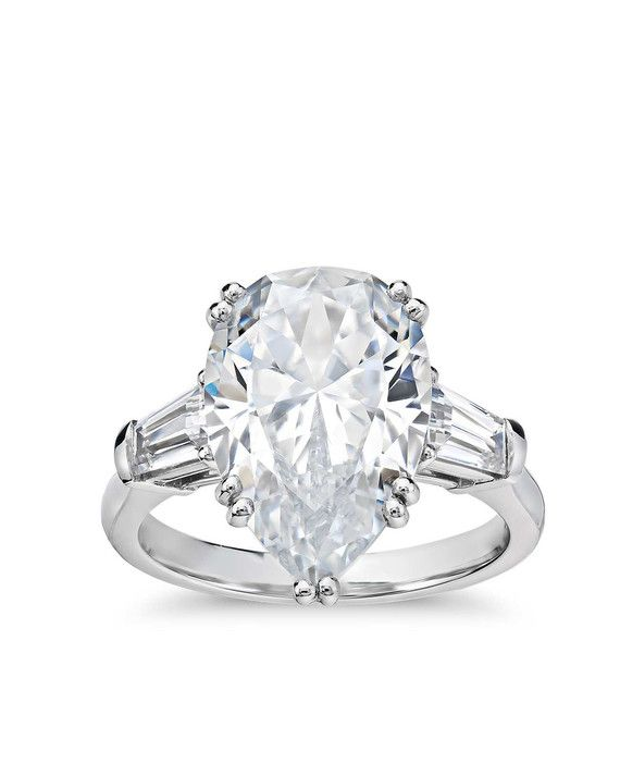 It's simple and understated until you realize you're dealing with an enormous prize of a high quality center diamond. The price for this piece starts with the setting and then each stone is weighed, evaluated, and picked on a case by case basis.    Blue Nile Studio Pear Tapered Baguette Engagement Ring, starting at $6,500, bluenile.com.