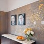 Gold, hand-painted walls by Ava Roth. This is what I want to do to my guest room. It will no doubt compromise my sanity though.