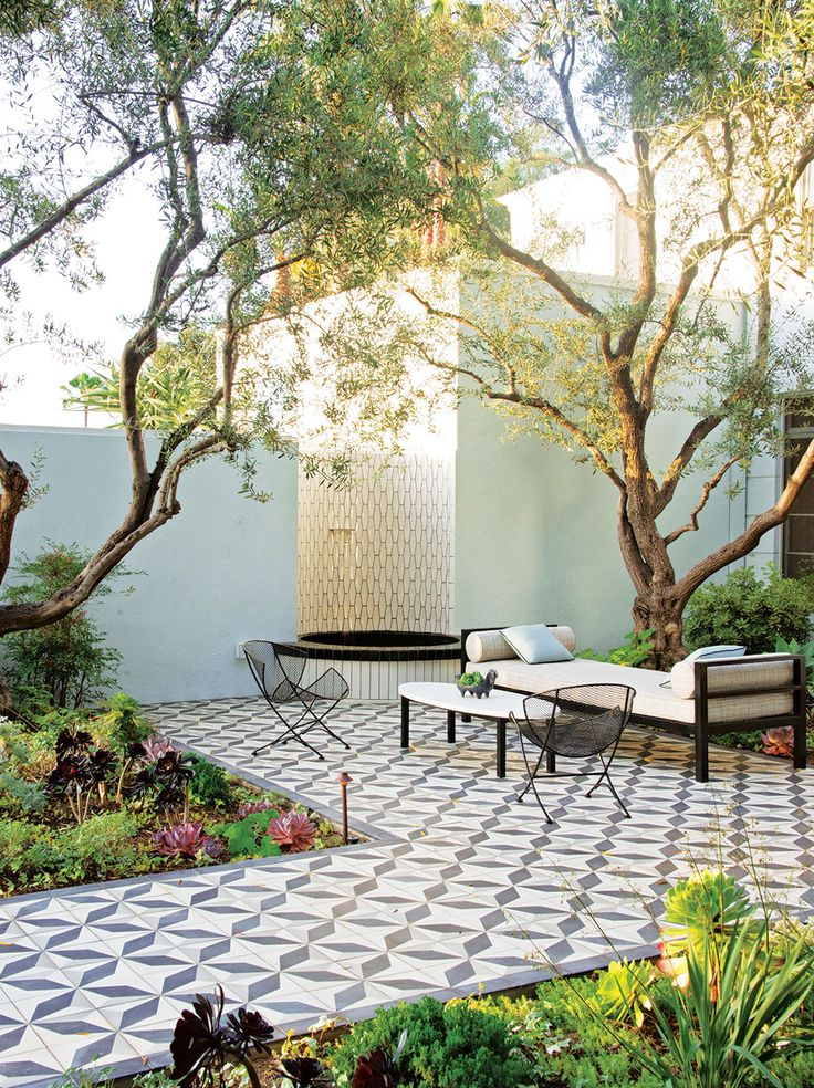 Entrance to front door. ( Heath Ceramics-tiled water feature and encaustic Granada Tile)