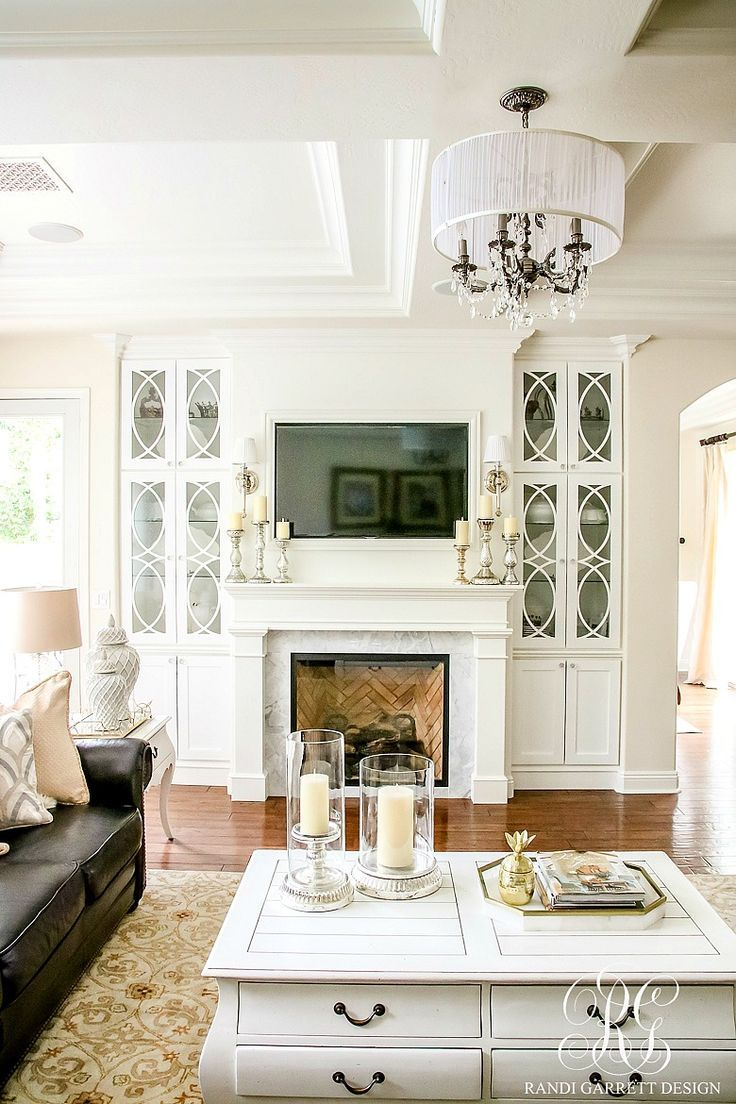 14 best old money style images on pinterest classic style white family room with dark leather couches pretty chandelier and coffered ceilings white glass