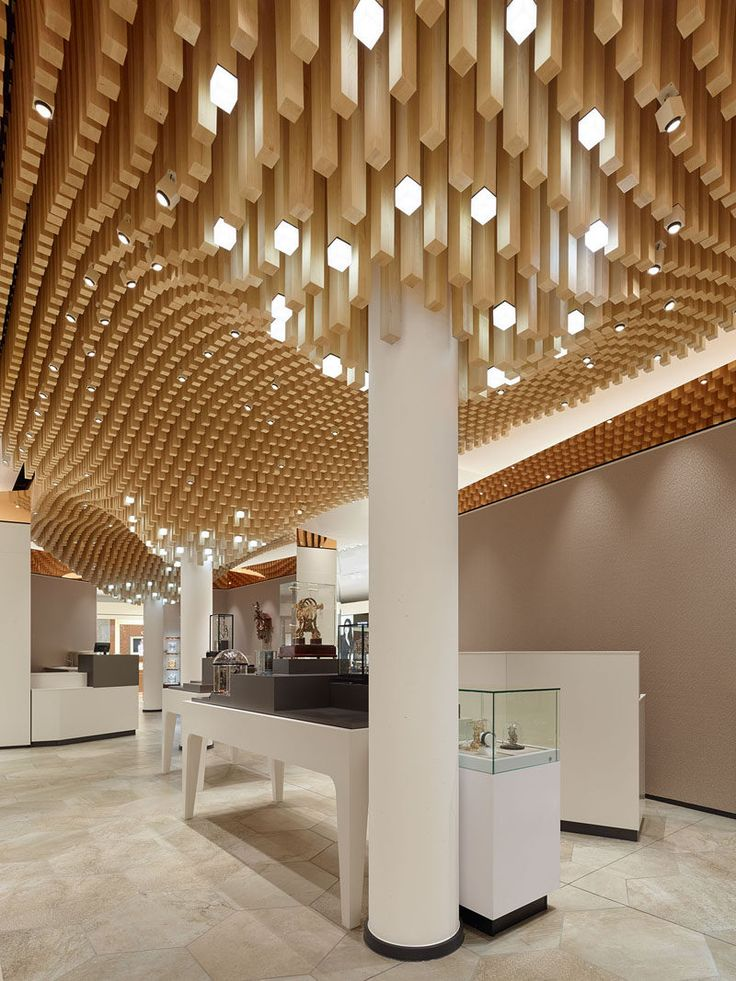 Ceiling Design Ideas 20 inspiring ceiling design ideas for your next home makeover 4362 Square Wooden Dowels Cover The Ceiling Of This Watch Showroom Modern Ceiling Designshowroom Ideasdesigner