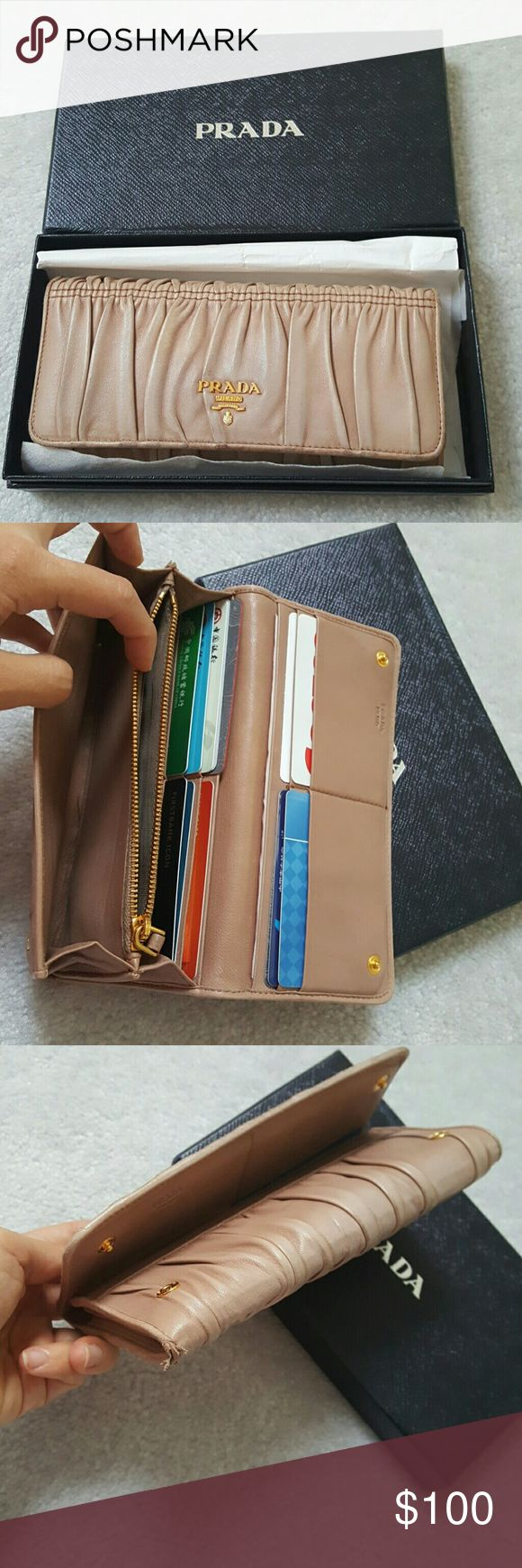 Used Authentic Prada Leather Beige Wallet Purse Used but in good condition. As shown in the pictures, the edge has been worn out , other than that, every thing is in good shape and conditions. Authentic Certified Prada wallet. Price is not negotiable. Prada Bags Wallets