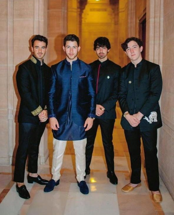 d85700d13 Nick Jonas and the Jonas brothers together - but this time not on stage!  The crew gathered together for brother Nick's epic wedding to Priyanka.