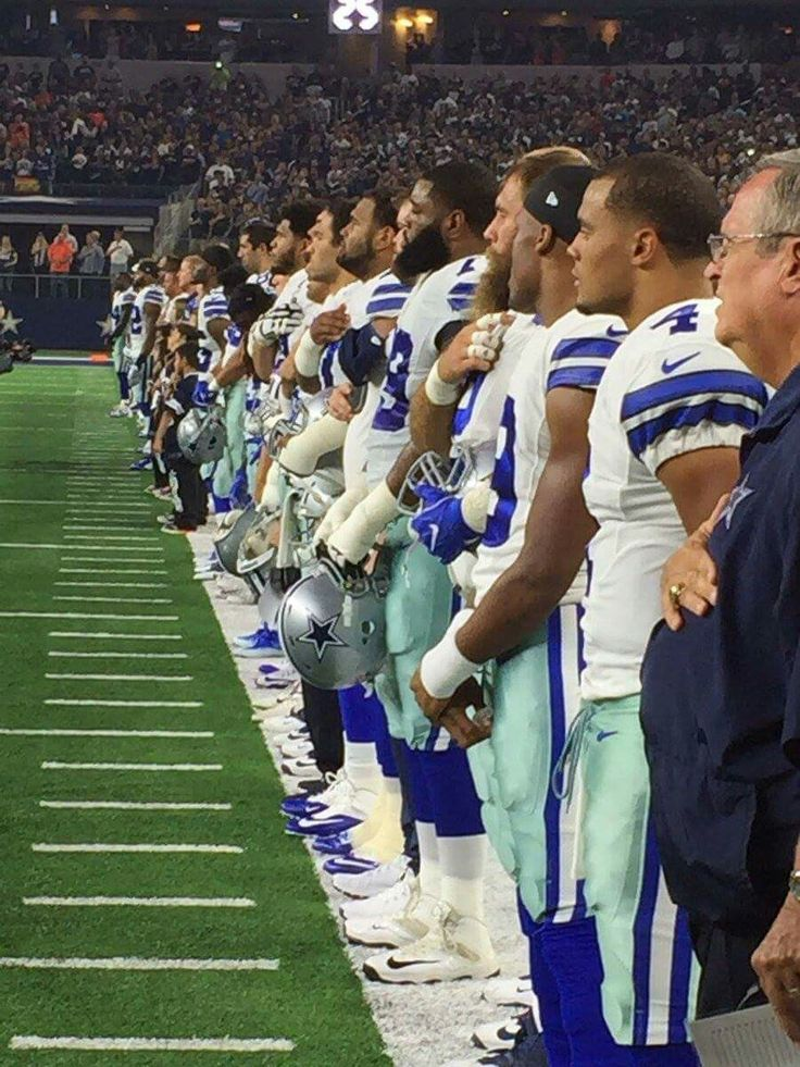 Cowboys players standing during the National Anthem before Sunday's Cowboys-Bears game.
