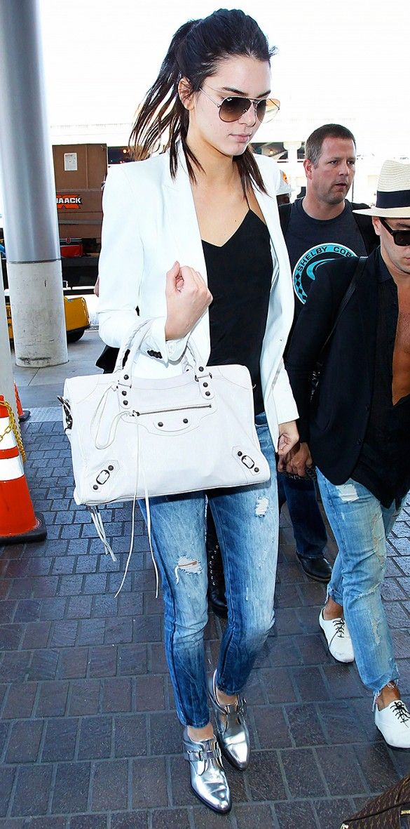 Kendall Jenner's airport outfit is centered around her Barbara Bui Mirror Leather Derby Shoes. That metallic shine makes a serious style statement! // #celebritystyle