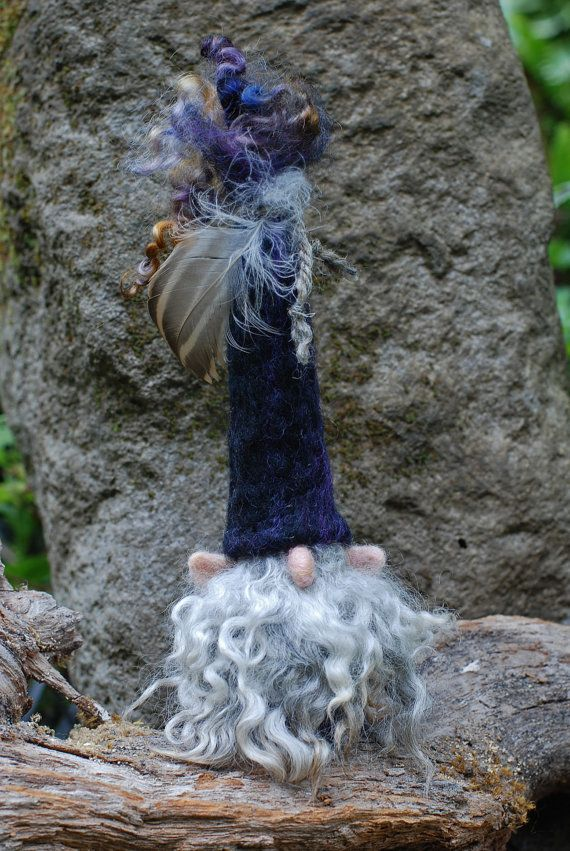 This listing is for one needle felted gnome wearing a cap made of wool in deep shades of black highlighted with blended fibers of deep purple,and