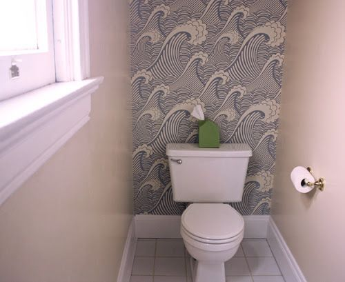 Here's a look at our upstairs guest bathroom. Last night I covered an accent wall with removable wallpaper. I love it! This bathroom has a peculiar layout. You walk in past the shower stall on the ri