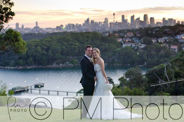 With the Sydney skyline at sunset in the background