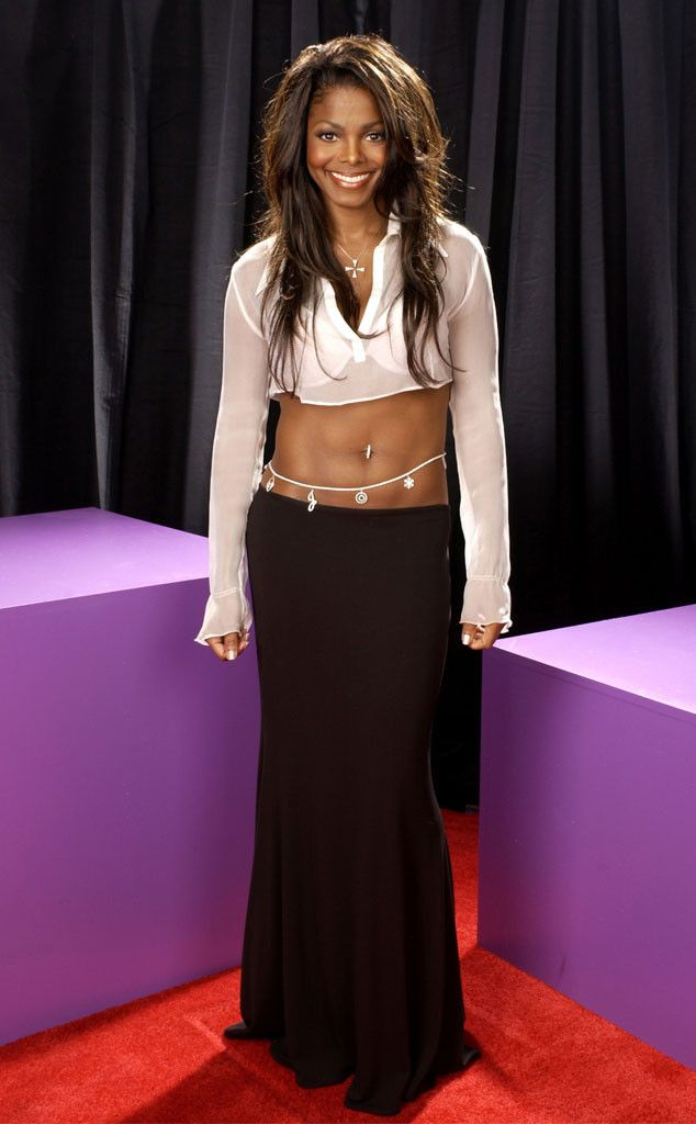 Belly-Bearing from Janet Jackson's Best Looks From Red Carpet to Concerts  The 2002 BET Awards presenter let her abs do the talking (again!) in a sheer white crop top and black maxi skirt.