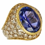 For those who are admirers of the famous Italian jewelry designer Buccellatti, this is a piece which draws inspiration for the famous jewelry maker. The deep intense blue tanzanite of 8 carats is bezel set in a amazing handmade filigree mounting. Textured for a vintage look. Truly unique and beautifully made.