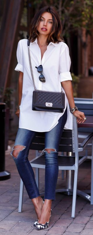 Annabelle Fleur in a smart casual outfit, white shirt, distressed skinny jeans and a black leather side bag   Shirt: Banana Republic, Jeans: Rag & Bone, Bag: Chanel