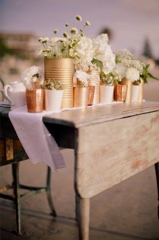 Easy DIY spray paint different size cans to use as vases on tables... use cooper, gold and or silver to give depth of color.