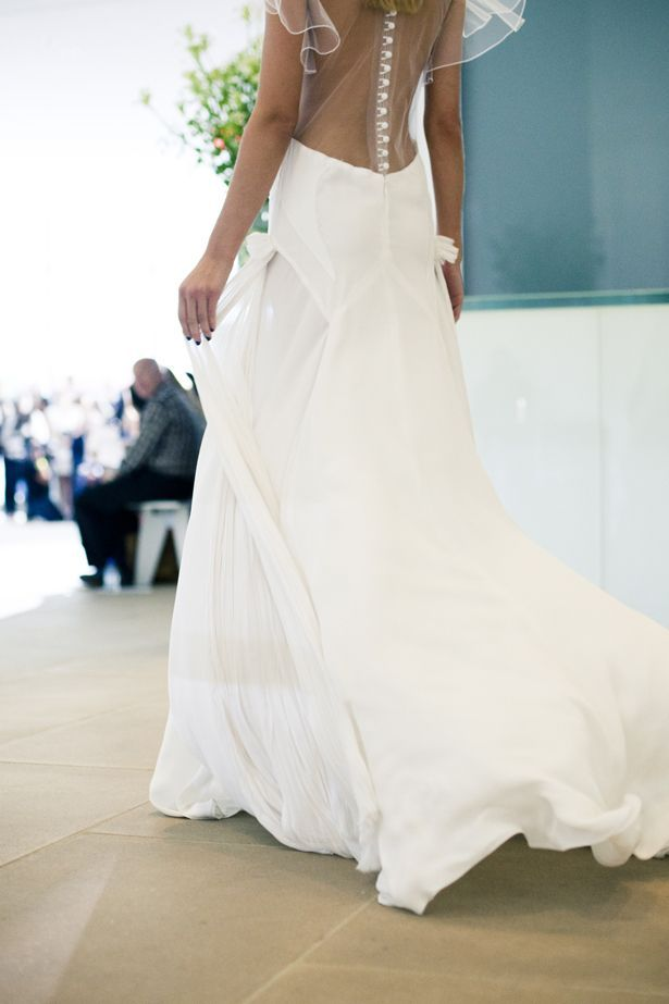 Bohemian bride wedding dress with sheer back with covered buttons
