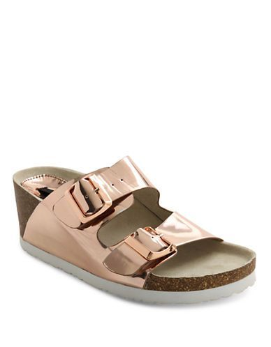 A fun extension of the classic footbed sandal, these funky wedges feature a lustrous metallic upper.