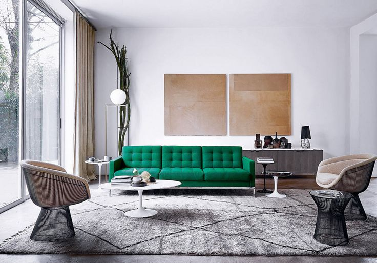An emerald green Florence Knoll sofa and a pair of Platner lounge chairs make for a gorgeous Knoll tableau.
