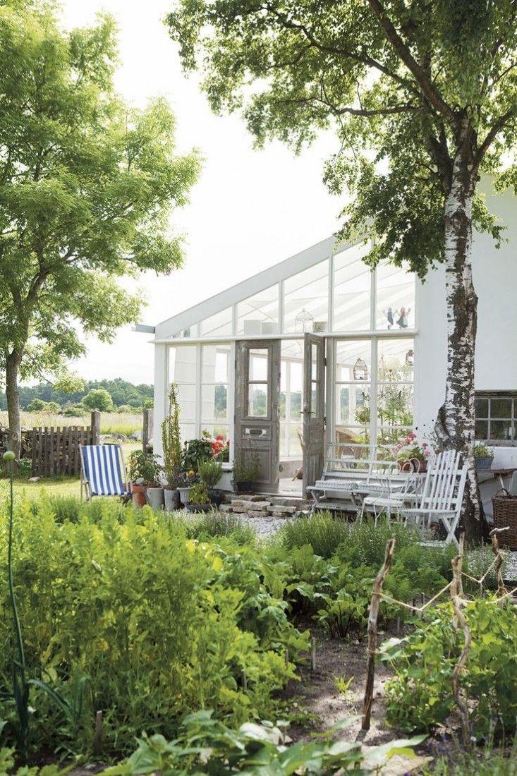 Lean-to from salvaged glass from a friend. I call that an inheritance. Gotland summer house garden Scandinavia ; Gardenista