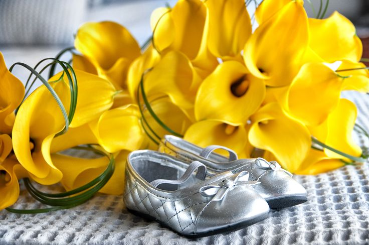 Bright yellow Calla Bouquet for someones special day, with the cutest little flower girl shoes.