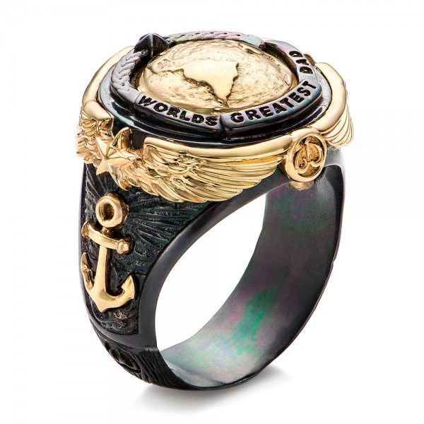 #101960 This ring is made of oxidized sterling silver and yellow gold is carved into these symbols:A Sail BoatAn AnchorThree PeopleThe EarthThe sail boat symbolizes the vessel...