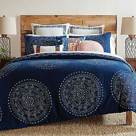 Bring a Bohemian look to your bedroom with the artsy Trina Turk Costa Mesa Medallion Comforter Set. Decked out in white and blue printed painterly medallions, the deep indigo bedding is a whimsical addition to any room's décor.