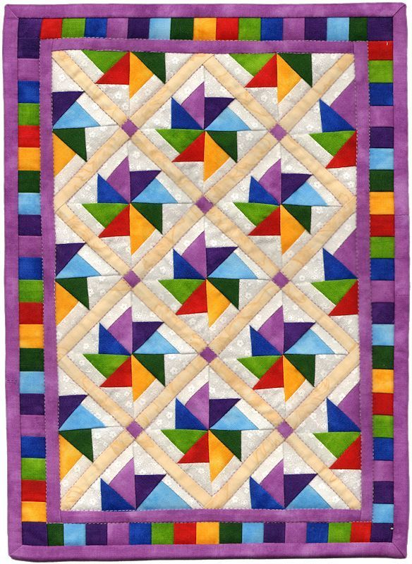 http://quiltedjonquil.com/wp-content/uploads/2012/05/Spinners-Two.jpg