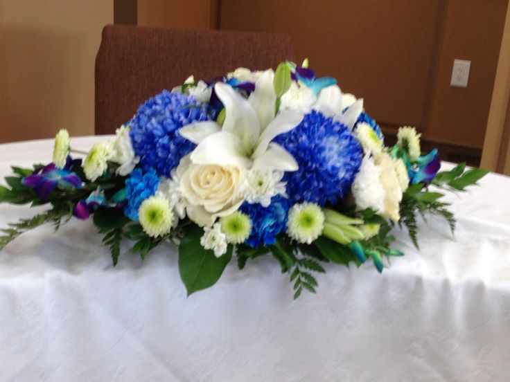 Royal blue and white ceremony arrangement.