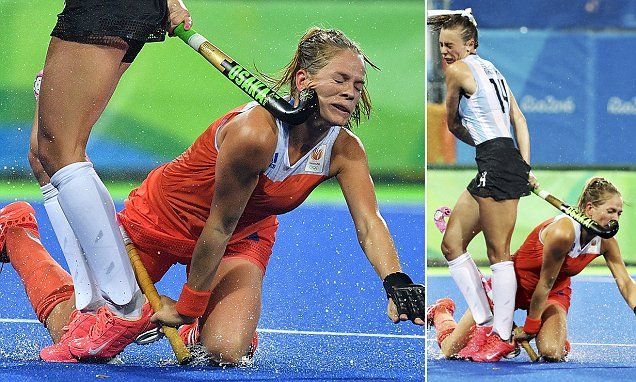 Netherlands hockey star is whacked in the face by an Argentina player