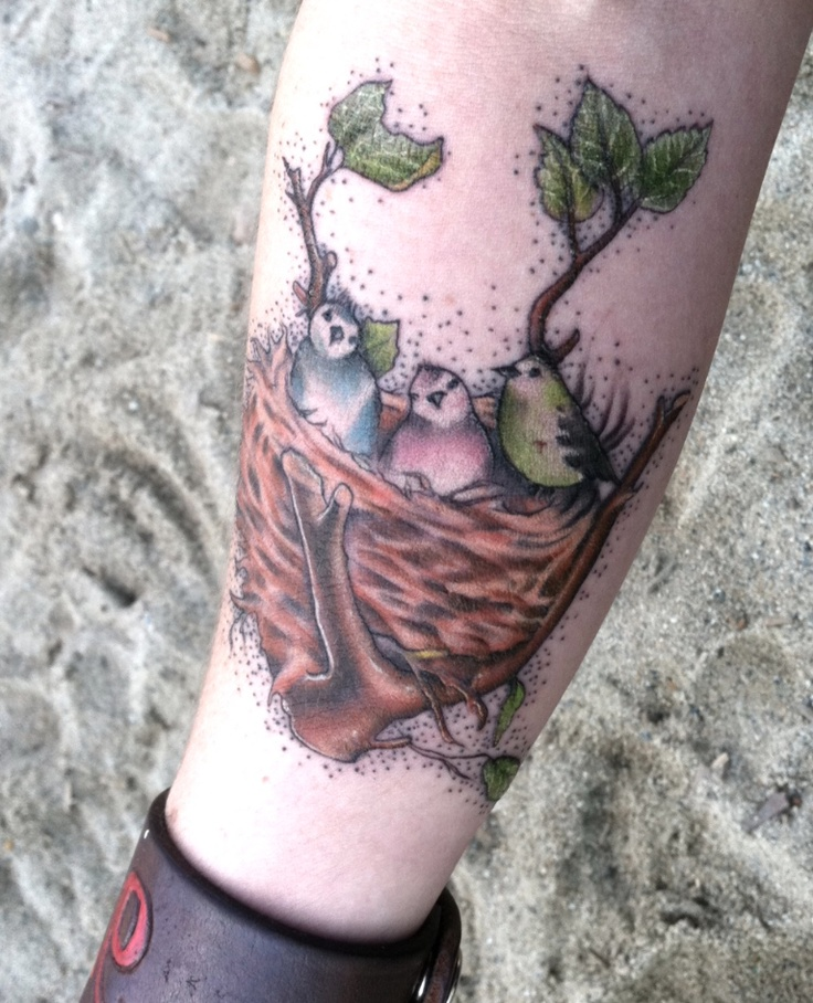 My forearm bird nest tattoo. This is my largest tattoo so far. Its an amazing piece by NY Ink's Tommy Montoya on my left forearm. My little bird nest with one bird for each of my babies. Love that it's girly and soft. Thanks Wooster Street Social Club!