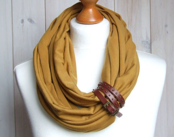 * Infinity circle scarf made of soft jersey * Scarf is embellished with leather cuff * Clasp can be worn separately as a bracelet on your hand *...