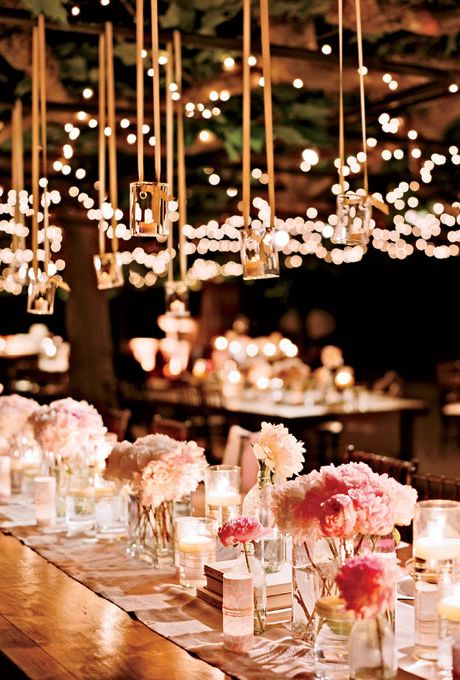 Pink peony wedding centerpieces with candles. Brides Real Wedding Leslie and Jeffrey in Napa.
