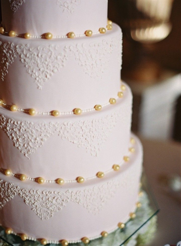 Photographer: Desi Baytan; Obsessed with this classy pearl and lace wedding cake!