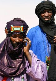 "In the Tuareg culture, the tagulmust is a 16 foot long turn that covers the face and wraps around the head. It is dyed and beaten with indigo that often rubs off on the skin, leading for the phrase, ""Blue People of the Sahara."""