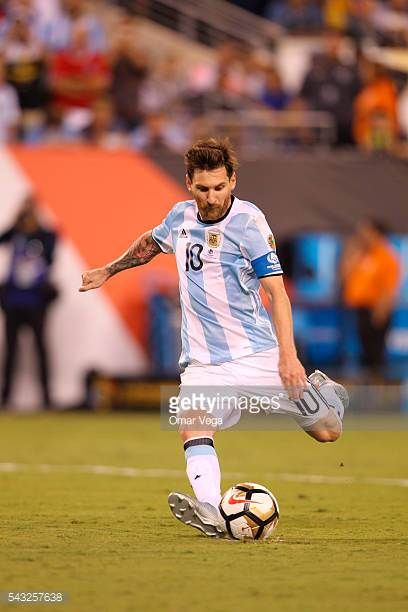 Lionel Messi of Argentina takes a penalty during the penalty shootout as part of the championship match between Argentina and Chile at MetLife...