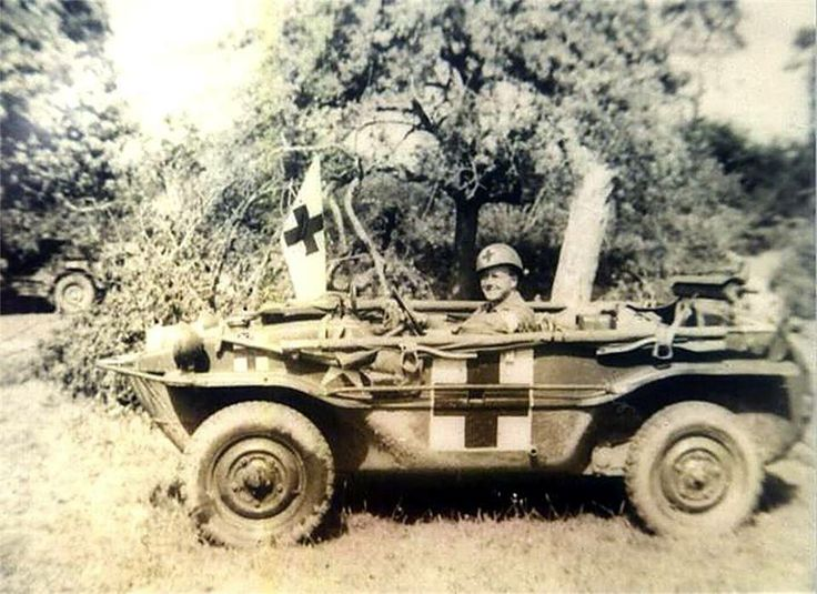 "Combat medic, Richard Bowman of the 704th Tank Destroyer Battalion's medical attachment is shown in a German ""Schwimmwagen"" somewhere in Normandy in 1944"